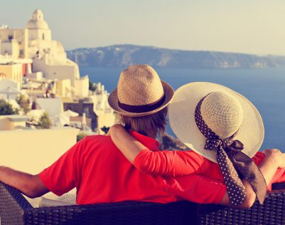 44692315 - happy young couple on vacation in santorini, greece