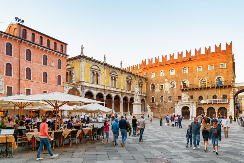 44536728 - verona, italy - august 24, 2014: street cafes on piazza delle erbe (market square) in verona, italy. verona is a popular tourist destination of europe.