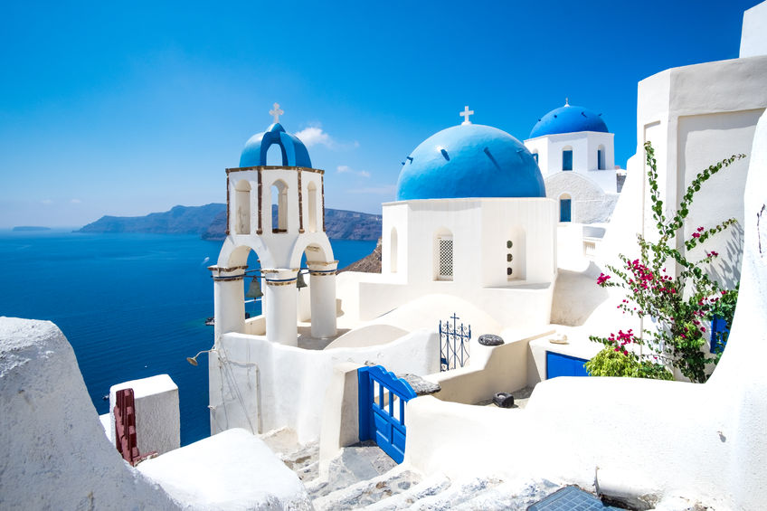 48901658 - scenic view of traditional cycladic white houses and blue domes in oia village, santorini island, greece