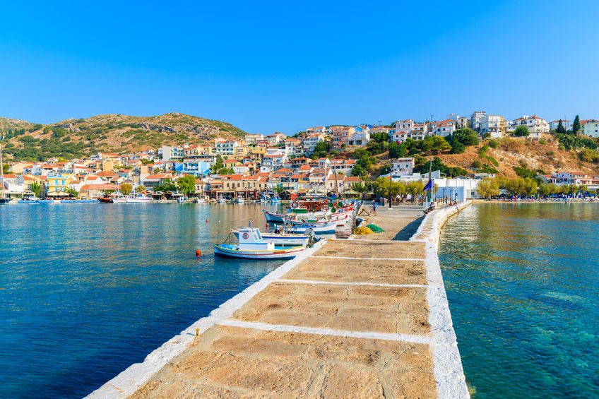 73946693 - pier in pythagorion port with fishing boats in distance, samos island, greece