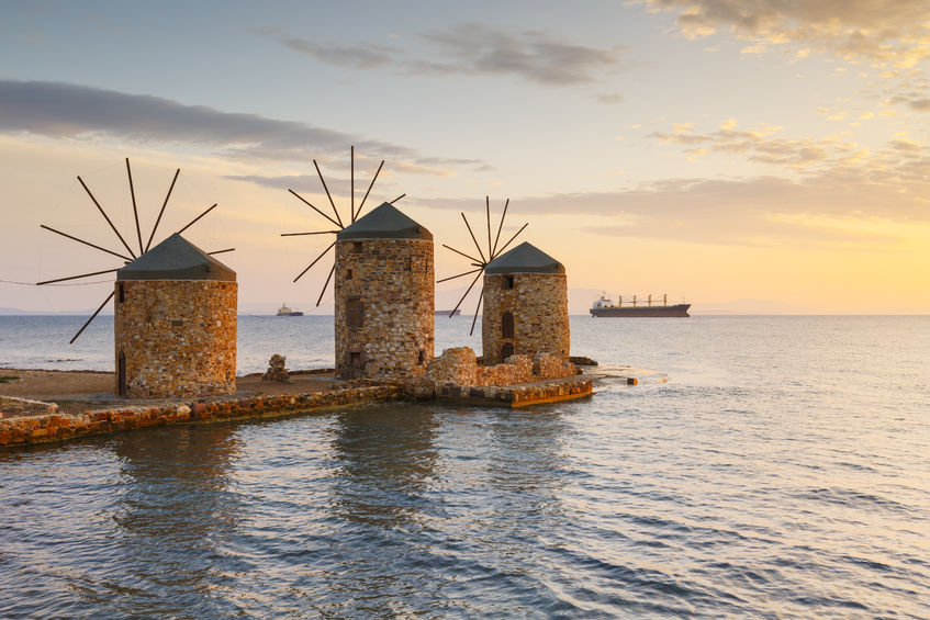 89909568 - sunrise image of the iconic windmills in chios town.
