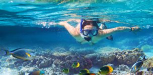 53176186 - young women at snorkeling in the tropical water
