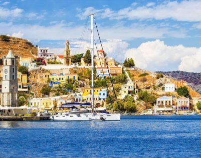 65787770 - greece. dodecanesse. island symi simi  colorful houses