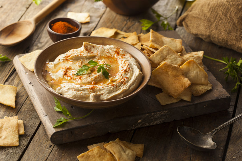 35958519 - healthy homemade creamy hummus with olive oil and pita chips