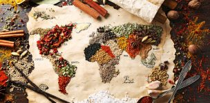 38930010 - map of world made from different kinds of spices on wooden background