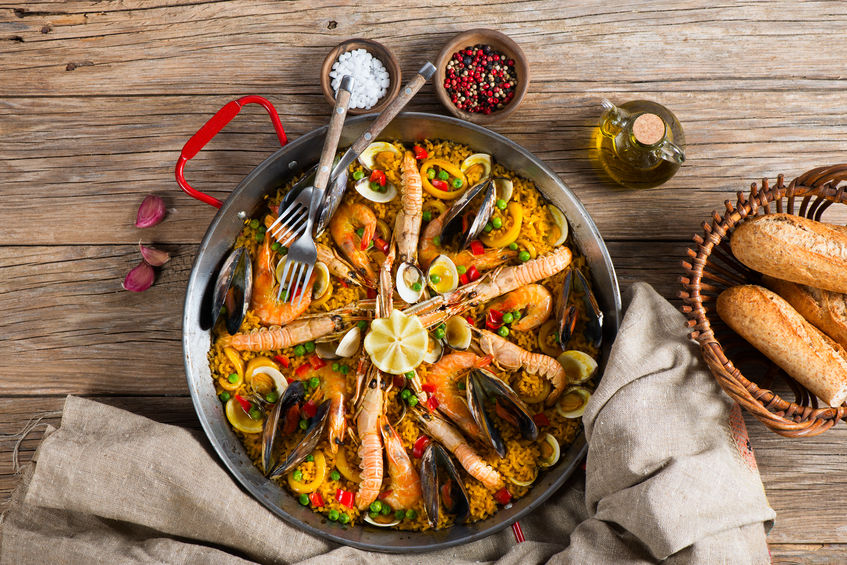 40928079 - top view of typical spanish seafood paella in traditional pan on a rustic wooden background