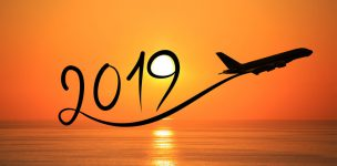 New year 2019 drawing by flying airplane on the air at sunrise