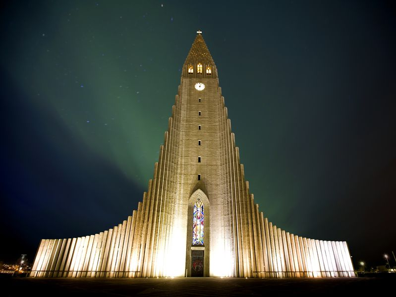 13248684 - northern lights shining over the church in reykjavik