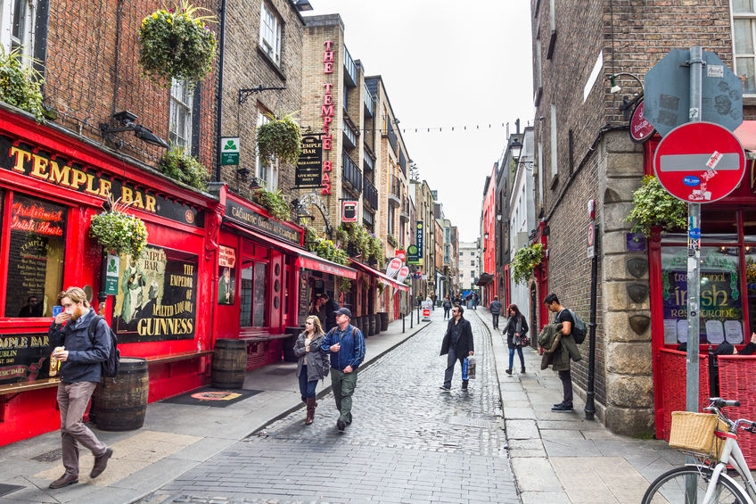 56386838 - dublin, ireland - 05 may, 2016: tourists walking in the temple bar area. the place is the cultural quarter in the center of the city and is full of restaurants, bars and nightclubs.
