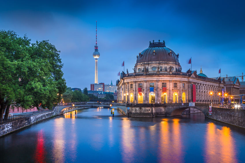 Beautiful view of Museumsinsel (Museum Island) with famous TV tower and Spree river in twilight during blue hour at dusk, Berlin, Germany