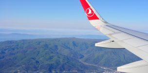 "ISTANBUL, TURKEY - APRIL, 2017: Wing of ""turkish airlines"" airplane over Istabul"